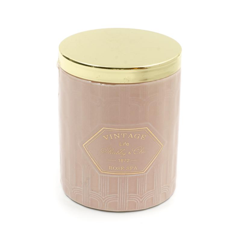 Elegáns gyertya rózsaszín kerámia tartóban, arany fedővel, fűszeres illatban