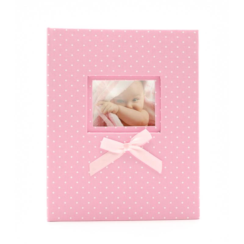 Közepes méretű, rózsaszín fehér pöttyös fotóalbum cserélhető képpel a borítóján, rózsaszín masnival